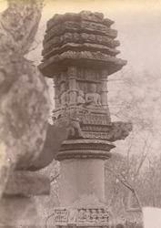 Close view of the top of one of the Jain votive pillars, Deogarh